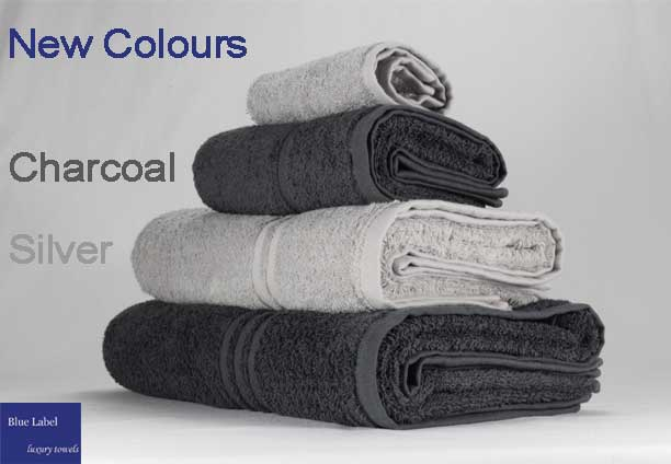 Blue Label towels in two shades of gres, light silver grey and dark charcoal grey.
